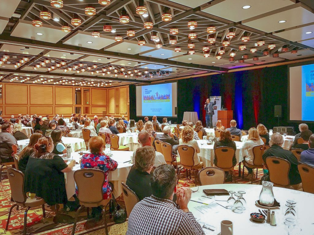 People sit during a conference
