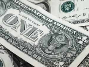 dollar bills in a loose pile