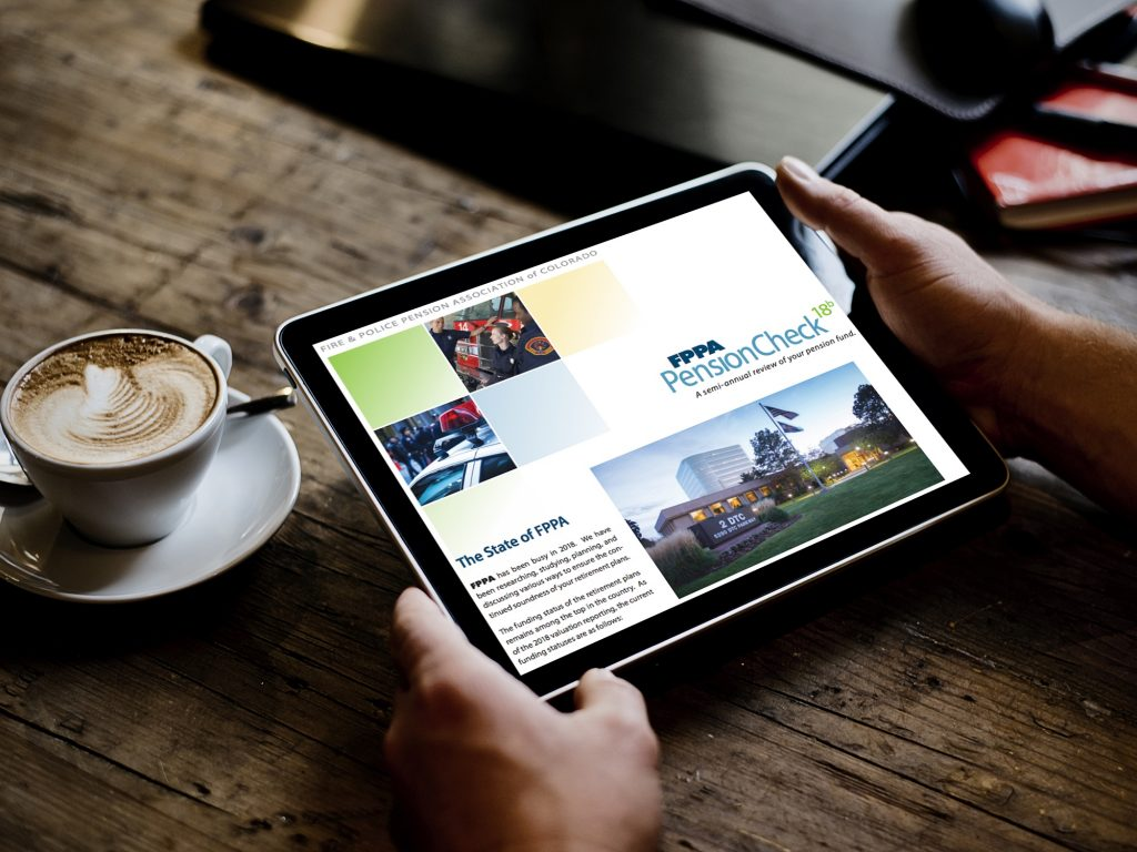 person looks at PensionCheck newsletter on tablet