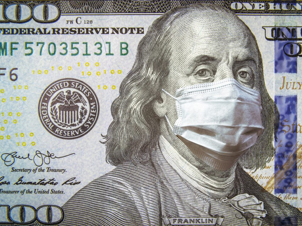 100 bill with Benjamin Franklin wearing a mask