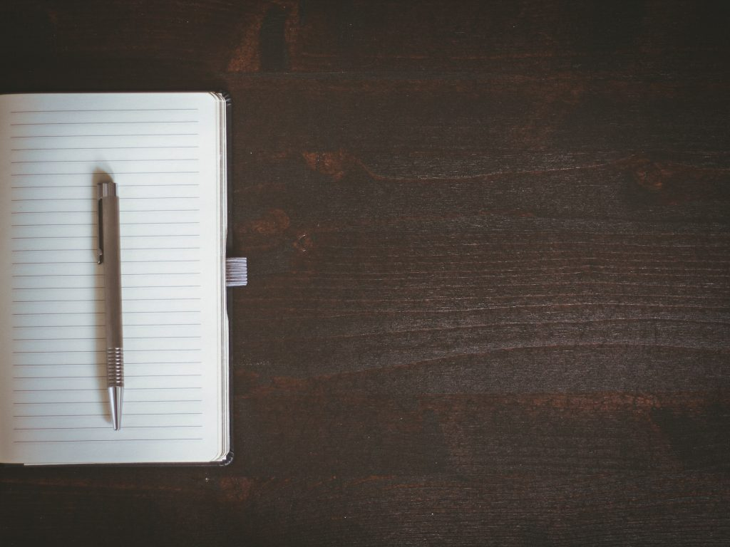 blank notebook on wooden table