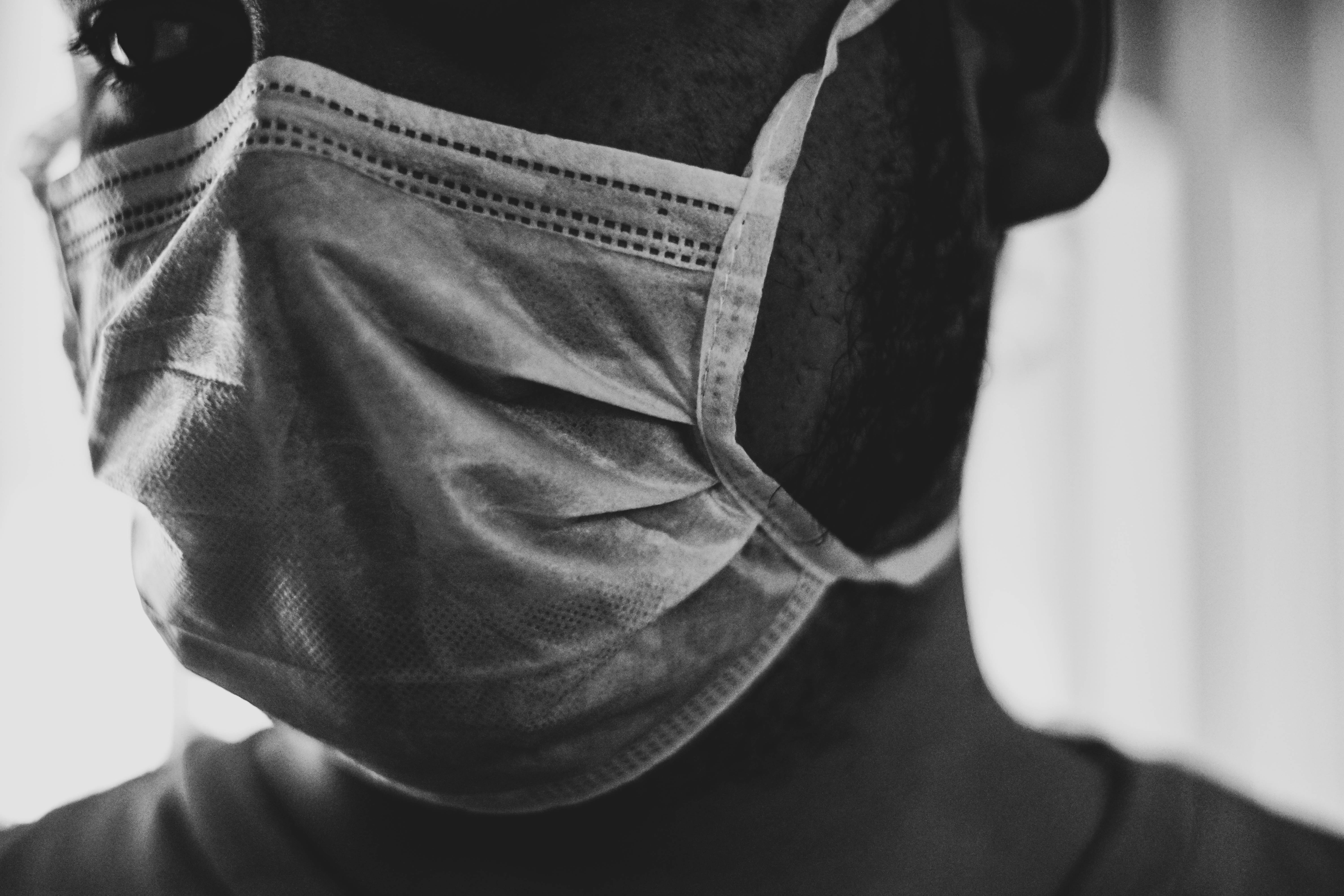 Close up of person wearing surgical mask