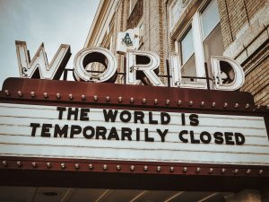 """marquee sign at world theater reading """"the world is temporarily closed"""""""