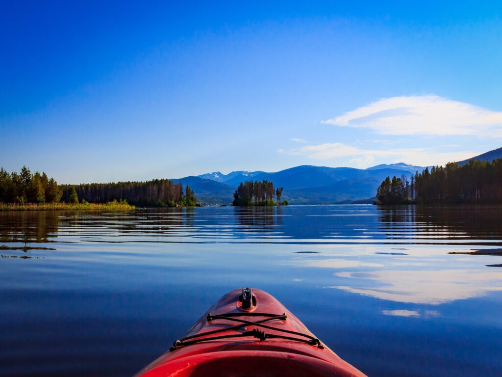 kayak glides across Grand Lake in Colorado