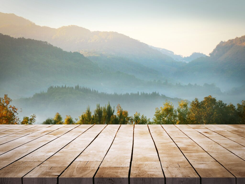 Wooden deck overlooking mountain scene
