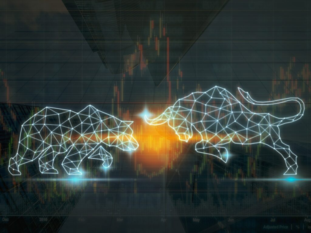 bear and bull outlines above stock market indicator graphs