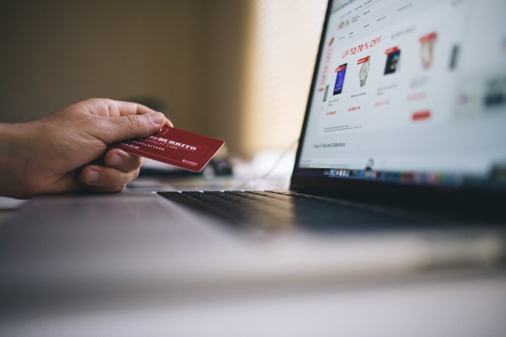 person holding a credit card, browses an online list of first responder discounts