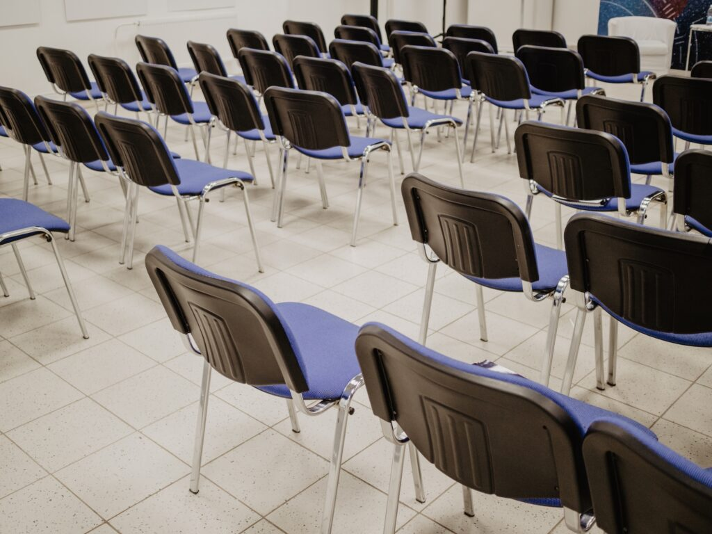 empty chairs lined up in a meeting hall