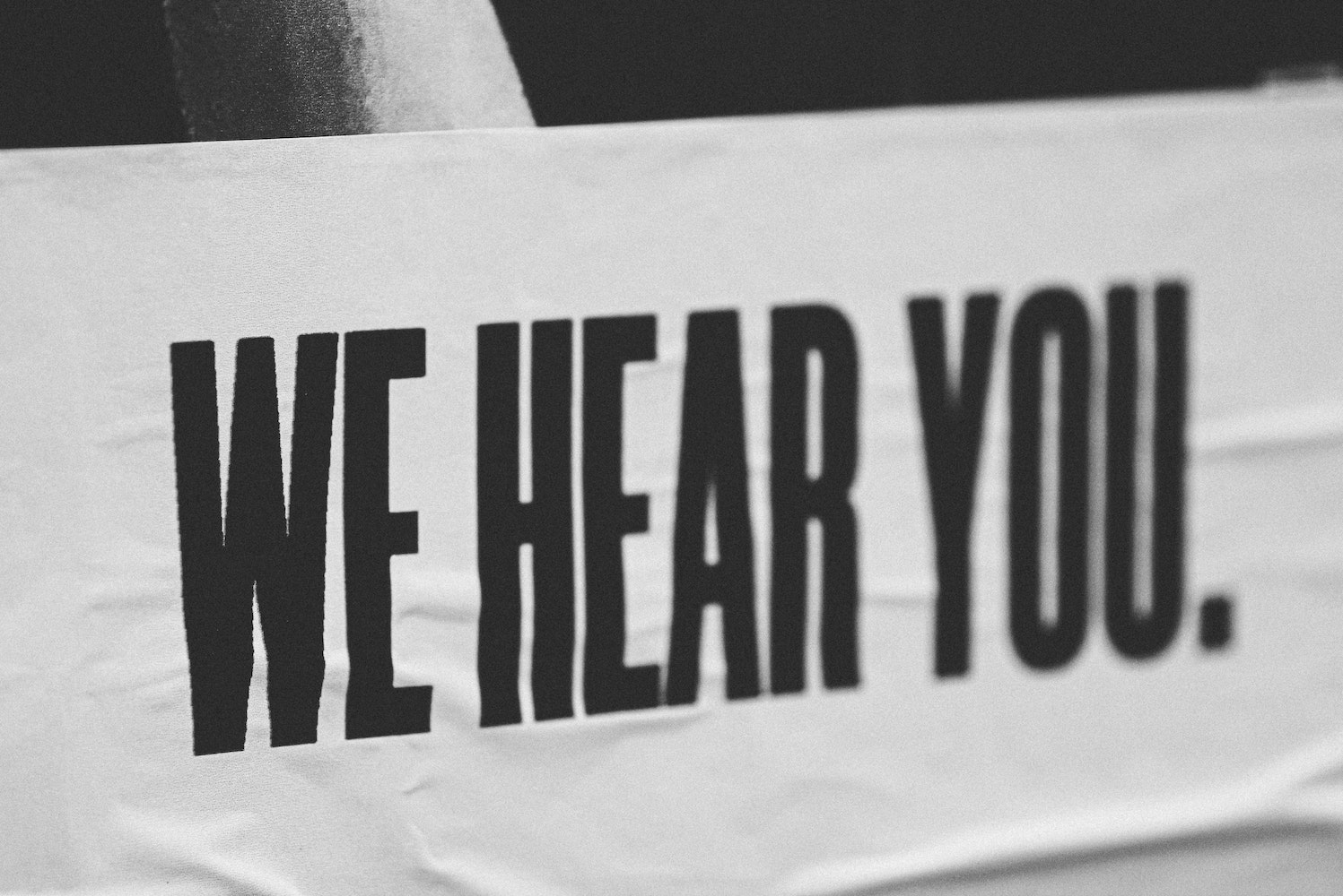 """posted banner reads """"We Hear You"""""""